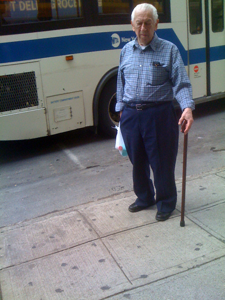 standing sleeping man with cane